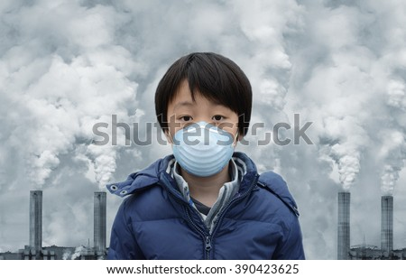 Asian boy wearing mouth mask against air pollution Royalty-Free Stock Photo #390423625
