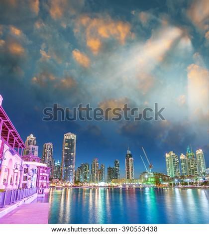 Tall buildings of Dubai at sunset, UAE. #390553438
