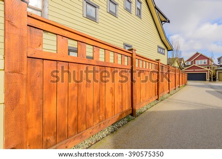wooden fence with houses #390575350