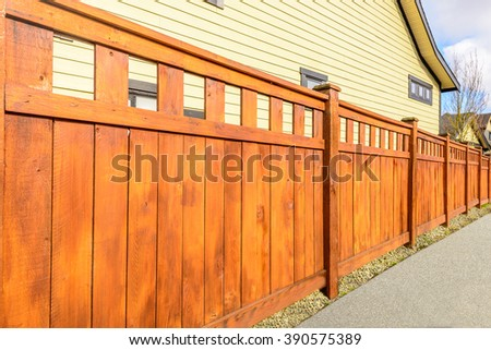 wooden fence with houses #390575389