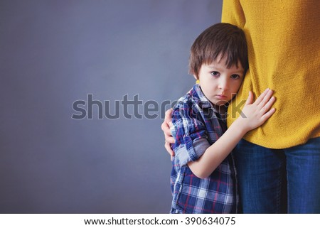 Sad little child, boy, hugging his mother at home, isolated image, copy space. Family concept #390634075