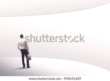 Young sales business person in elegant suit standing with his back in empty white space background with curved lines concept #390641689