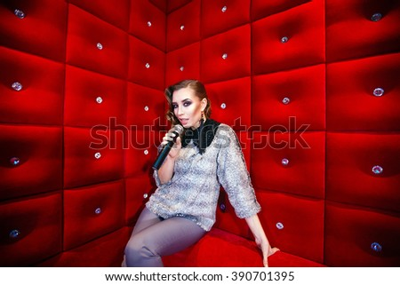beautiful girl singing karaoke in a nightclub #390701395