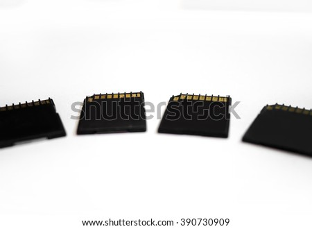 Four SD black memory cards over white background #390730909
