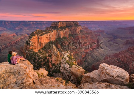 (Untouched) a group of people was sitting near the edge watching sunset at Grand Canyon National Park North Rim, USA. Grand Canyon National Park is one of the world's natural wonders. Royalty-Free Stock Photo #390845566
