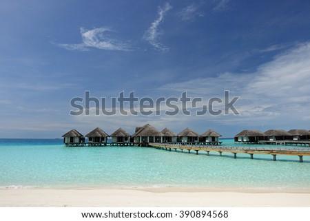 Beautiful beach with water bungalows at Maldives #390894568