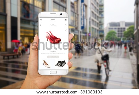 Online shopping with smart phone. Phone in woman hand. Buying women shoes on online store. Street walk and visiting shopping malls. #391083103