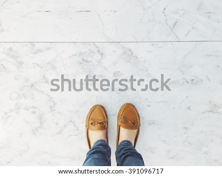 Selfie of feet in fashion leather flat shoes on pavement background, top view and copy space, social distancing keep distance in public  #391096717