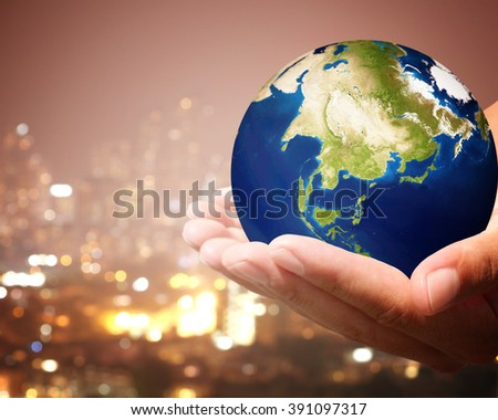 The world is on hold for the city bokeh blur background.  Elements of this image furnished by NASA. #391097317