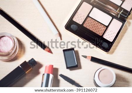 Makeup set of beige, brown, pink eyeshadows, eye pencil, lip pencil, lipstick and mascara #391126072