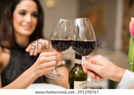 Couple toasting wineglasses in a luxury restaurant #391298767