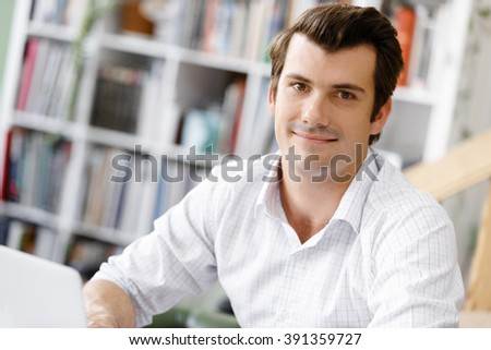 Young businessman in office #391359727