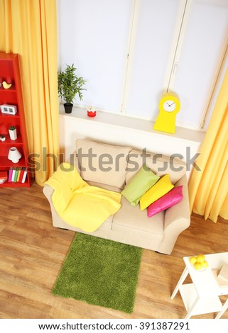 Modern living room interior with beige sofa and small green carpet #391387291