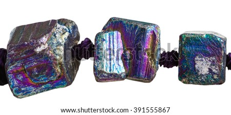 three beads from iridescent (rainbow) pyrite gem stones close up isolated on white background #391555867