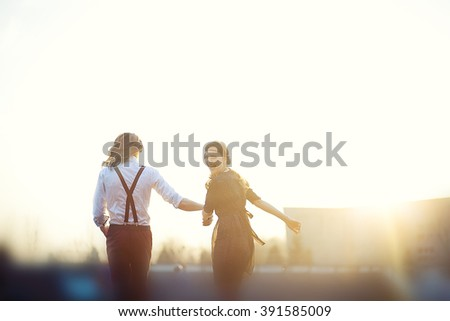 Love story. Silhouette romantic love couple blurred nature and sunset. valentine's day; love heart; love couple #391585009