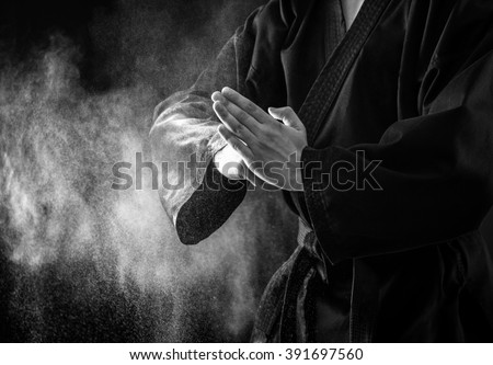 Closeup of male karate fighter hands. Black and white. Royalty-Free Stock Photo #391697560