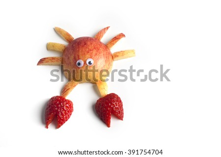 Food art creative concepts. Cute crab made of apples and strawberry isolated on white background.