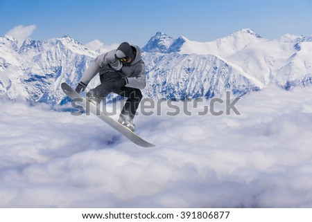 Snowboarder making jump, extreme mountain freeride. #391806877