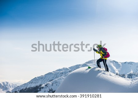 Skier walking on top of the mountain. #391910281