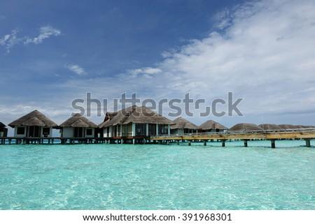 Beautiful beach with water bungalows at Maldives #391968301