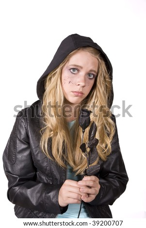 Girl with a sad expression holding a rose and looking #39200707