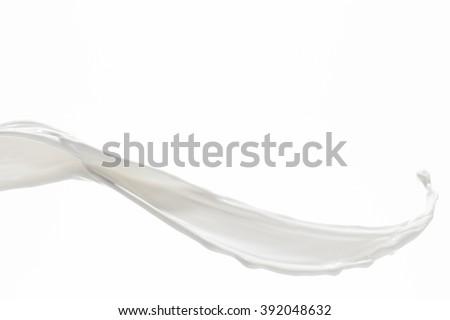 Milk Splash On White Royalty-Free Stock Photo #392048632