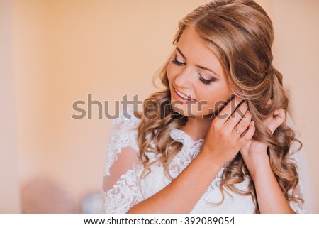 beautiful gorgeous stylish bride getting ready in the morning in the room #392089054
