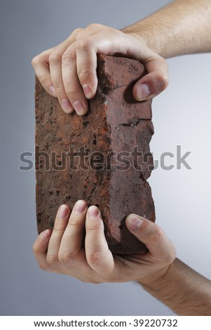 Hands holding an old brick #39220732