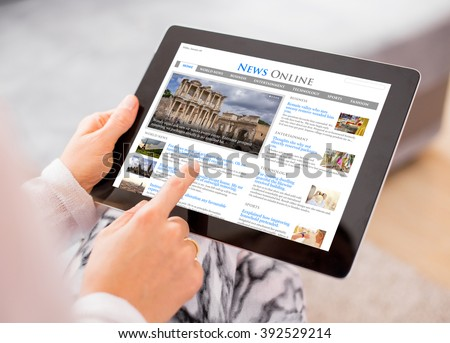 Sample news website on digital tablet. Contents are all made up. #392529214