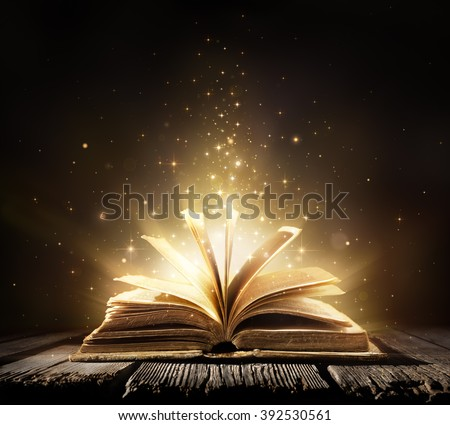 Old Book With Magic Lights On Vintage Table  Royalty-Free Stock Photo #392530561