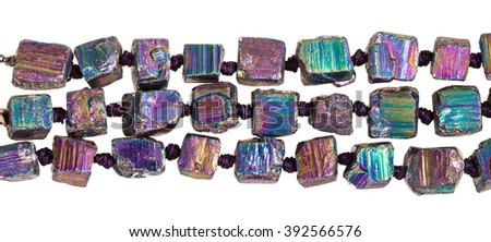 strings of beads from iridescent (rainbow) pyrite gem stone isolated on white background #392566576