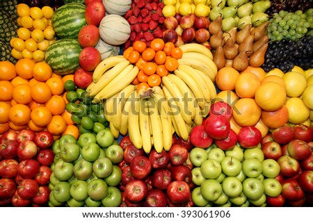 Big assortment of fresh organic fruits. Frame composition of fruits on market stall #393061906
