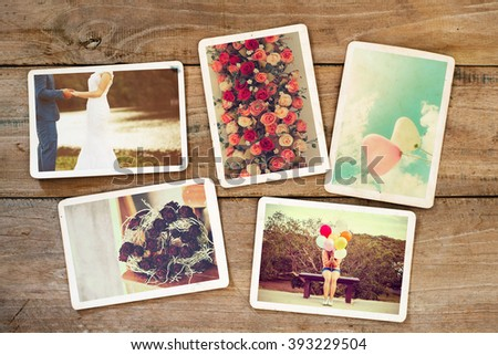 Instant photo album of remembrance and nostalgia in wedding and honeymoon on wood table. paper photo of film camera - vintage and retro style