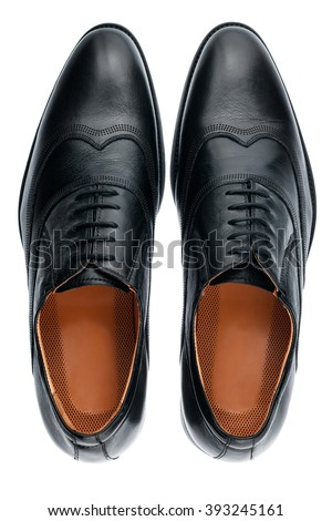 Classic male black leather shoes isolated on a white, top view Royalty-Free Stock Photo #393245161
