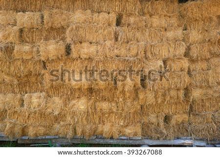 Hay stacks background, stacks on wood beams #393267088