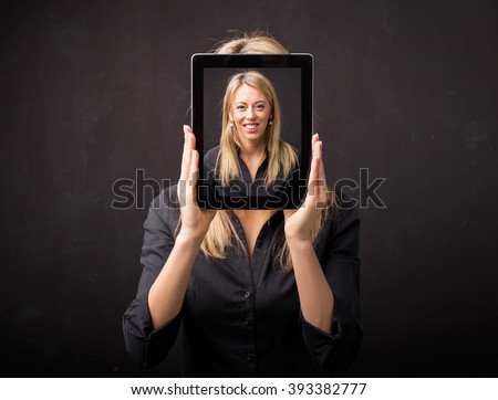 Woman holding tablet with her happy face
