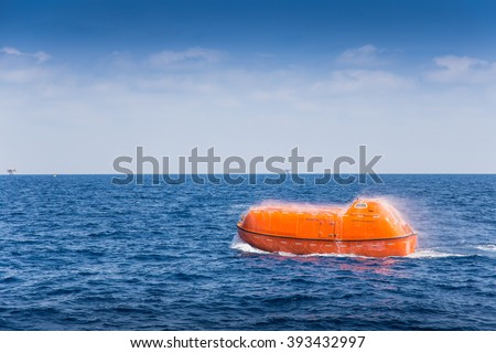 rescue boat or life boat at oil and gas platform annual sea trial test for preventive maintenance and testing to spry water for cool down when escaping or evacuate from fire when abandon platform #393432997