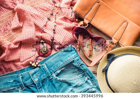 clothing for women, placed on a wooden floor. Royalty-Free Stock Photo #393445996