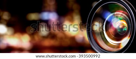 Camera lens with lense reflections. Royalty-Free Stock Photo #393500992