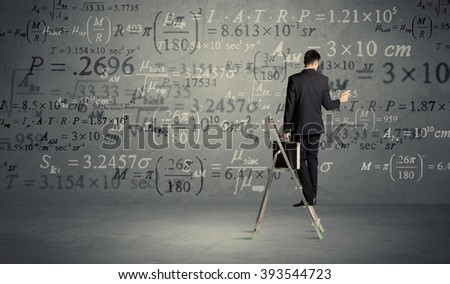 A businessman in modern stylish elegant suit standing on a small ladder and drawing pie and block charts on grey wall background with exponential progressing curves, lines,  angles, blocks, numbers #393544723