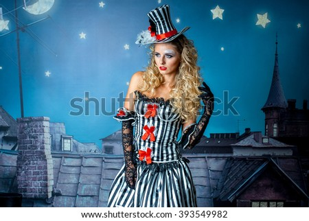 young pretty blonde girl posing at a rooftop under the starry sky #393549982
