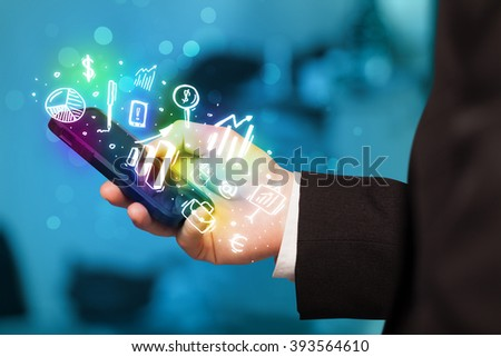 Smartphone with finance and market icons and symbols concept #393564610