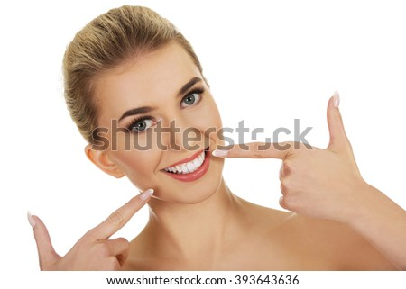 Woman showing her white teeth. #393643636