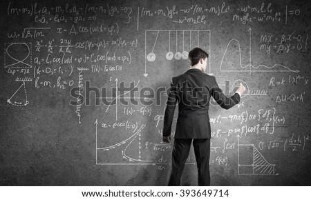 Teacher at the blackboard #393649714