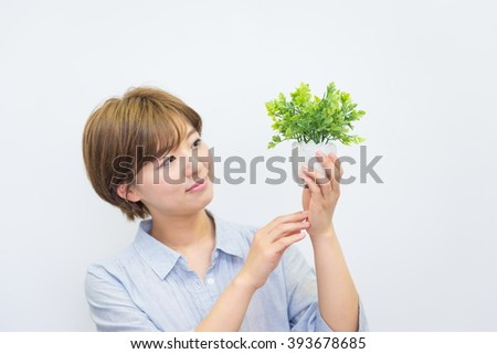 asian woman with plant #393678685