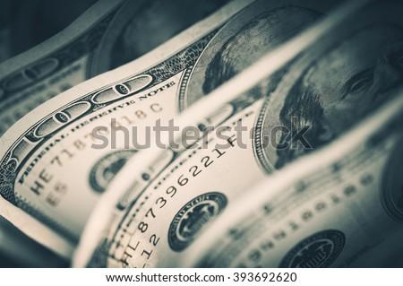 Dollars Closeup Concept. American Dollars Cash Money. One Hundred Dollar Banknotes. Royalty-Free Stock Photo #393692620