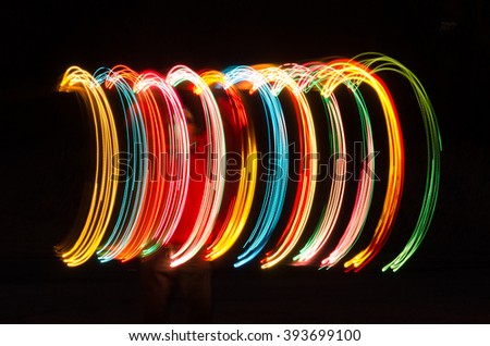 Colorful abstract created by night painting using moving lights in the dark and long exposure.