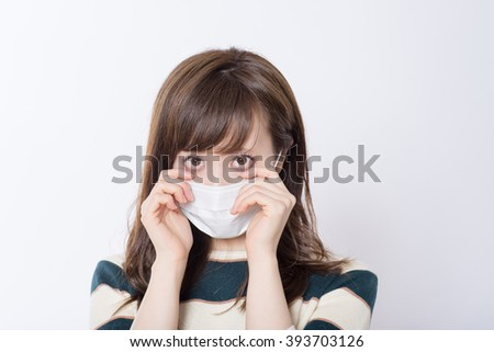 Japanese Women who suffer from hay fever #393703126