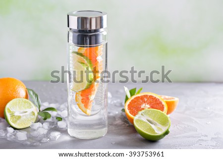Infused water with orange and lime in a bottle #393753961
