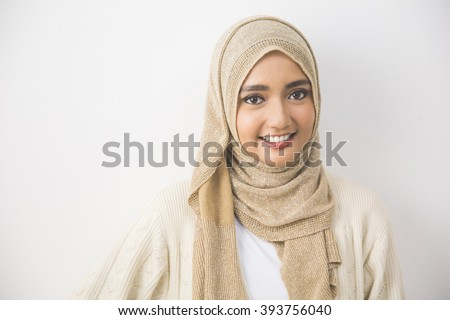 portrait of pretty oung asian muslim woman in head scarf smile #393756040